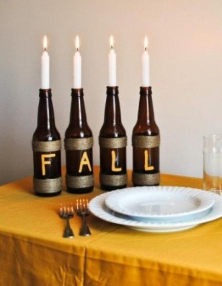 """<div class=""""caption-credit""""> Photo by: StyleCaster</div>Why not put those beer and wine bottles to work even after you've taken the last sip? We've seen candles in wine bottles before, but the painted on letters and twine wrapped around these bottles are especially fun and seasonal. <br> Image Via Big City Little Joys"""