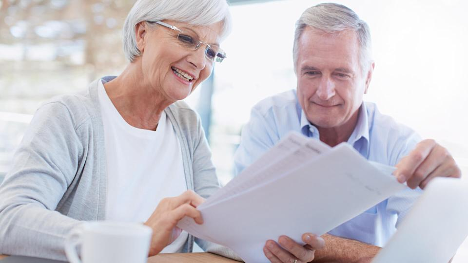 Shot of a senior couple working on their finances using a laptophttp://195.