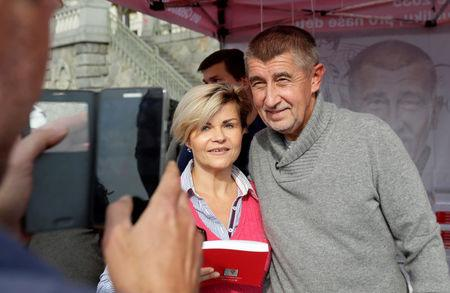 The leader of ANO party Andrej Babis poses for a photo with a supporter during an election campaign rally in Prague