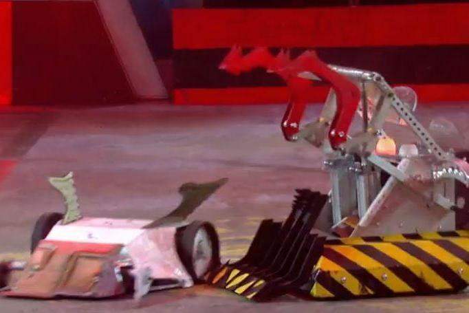 Head to head: Team Cherub's robot (left) battles with Team Behemoth's robot (right) (BBC Two Robot Wars)