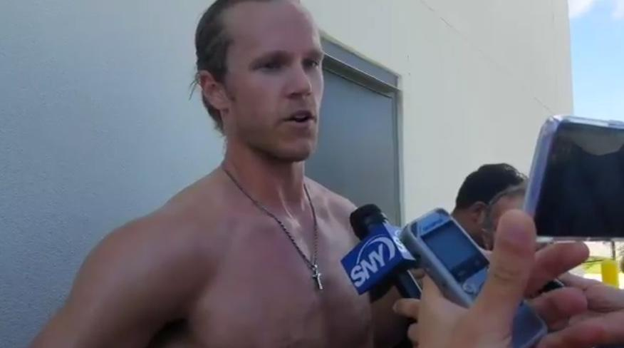 The Mets' Noah Syndergaard answers questions without a shirt after his first spring training start of 2018. (Twitter/@MattEhalt)