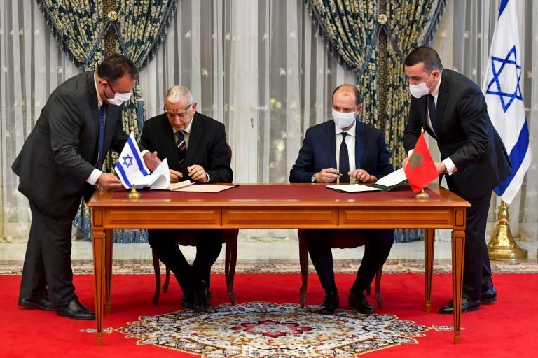 Representatives of Israel and Morocco sign landmark agreements at the Royal Palace in the Moroccan capital Rabat on December 22, 2020