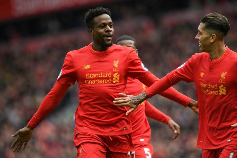 Liverpool's Divock Origi (left) celebrates after scoring his side's third goal in the 3-1 victory over Everton in the Merseyside derby at Anfield on April 1, 2017