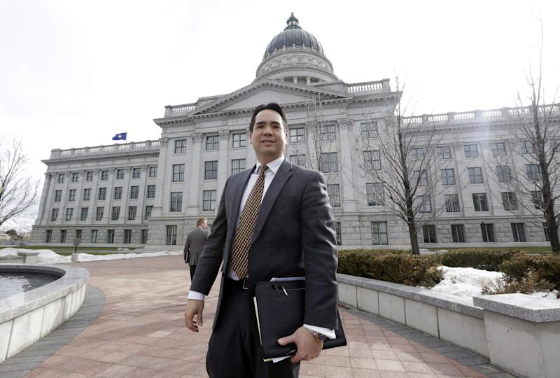 FILE - In a Tuesday, Feb. 11, 2014 file photo, Utah Attorney General Sean Reyes stands outside the Utah Sate Capitol in Salt Lake City. Reyes is hoping for extra help from lawmakers to pay for the state's legal fight over same-sex marriage. In Utah, Oklahoma, Kentucky and Virginia, federal judges have struck down part or all of the bans on same-sex marriage that voters approved between 2004 and 2006. Each of the rulings has been stayed, pending appeals, but the trend is unsettling to the activists who oppose gay marriage. (AP Photo/Rick Bowmer, File)