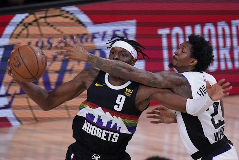 Denver Nuggets' Jerami Grant (9) is defended by Los Angeles Clippers' Lou Williams (23) during the first half of an NBA conference semifinal playoff basketball game, Wednesday, Sept. 9, 2020, in Lake Buena Vista, Fla. (AP Photo/Mark J. Terrill)