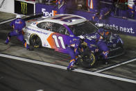 Denny Hamlin makes a pit stop during the NASCAR Daytona 500 auto race at Daytona International Speedway, Sunday, Feb. 14, 2021, in Daytona Beach, Fla. (AP Photo/Chris O'Meara)