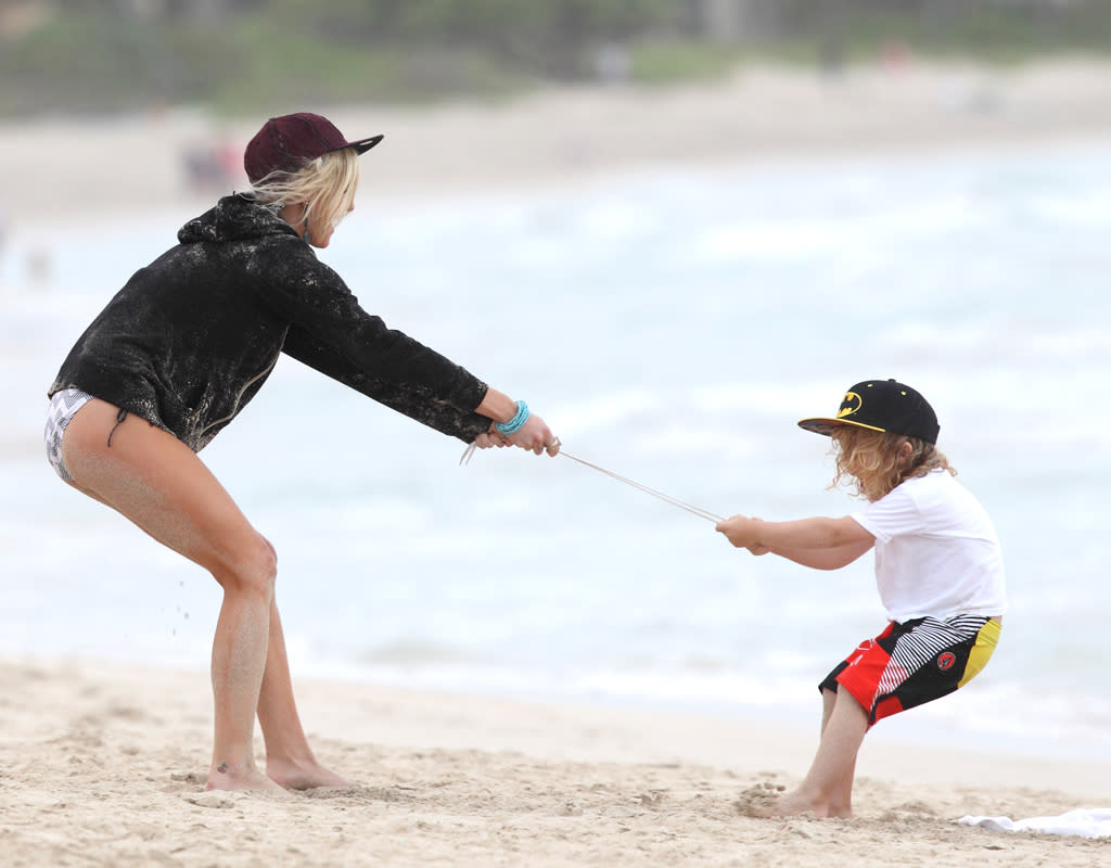 Ashlee Simpson, Bronx and family have a sand fight on the beach in Hawaii. Ashlee and Bronx have a great time throwing sand and playing on the beaches of Hawaii. Pictured: Ashlee Simpson and Bronx Mowgli Wentz Ref: SPL475579  271212  Picture by: Splash News   Splash News and Pictures Los Angeles:310-821-2666 New York:212-619-2666 London:870-934-2666 photodesk@splashnews.com