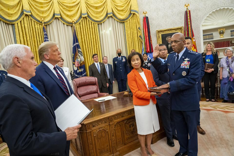 U.S. President Donald Trump, second frVice President Mike Pence and President Trump participate in the swearing in of General Charles Q. Brown, as the incoming Chief of Staff of the Air Force in August. (Doug Mills/Bloomberg via Getty Images)om left, and Vice President Mike Pence, left, participate in the swearing in of General Charles Q. Brown, as the incoming Chief of Staff of the Air Force at the White House in Washington, D.C., U.S., on Tuesday, Aug. 4, 2020. (Doug Mills/Bloomberg via Getty Images)