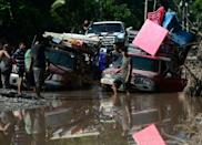 Banana workers stranded at a flooded road while trying to evacuate from El Progreso in Yoro, Honduras, ahead of the arrival of Iota