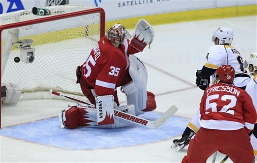 Nashville Predators defenseman Kevin Klein (8) scores on Detroit Red Wings goalie Jimmy Howard (35) during the second period of Game 3 of an NHL hockey Stanley Cup first-round playoff series in Detroit, Sunday, April 15, 2012. (AP Photo/Carlos Osorio)