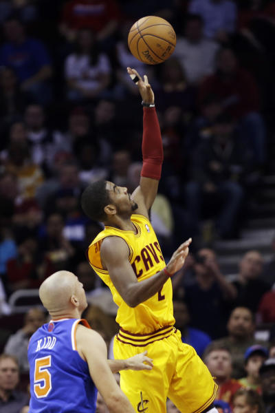 Cleveland Cavaliers' Kyrie Irving (2) shoots against New York Knicks' Jason Kidd (5) during the first quarter of an NBA basketball game, Monday, March 4, 2013, in Cleveland. (AP Photo/Tony Dejak)