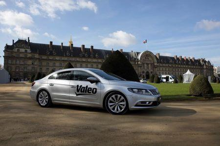 The new self-driving car unveiled by Valeo and Safran drives during a presentation in front of the Invalides in Paris