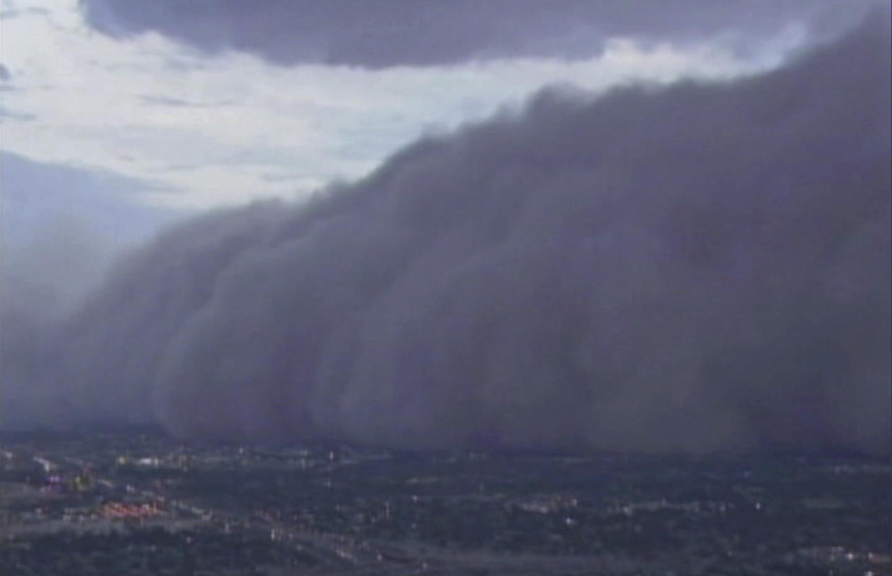 In this image from ABC15.com a large dust storm rolls across downtown Phoenix, Arizona Tuesday evening July 5, 2011. The massive dust storm redued visibility and delayed flights as strong winds toppled trees and caused power outages for thousands of residents in the valley.(AP Photo/ABC15.COM)