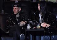 """<p>After being friends for years, with Travis even making a few appearances on <strong>Keeping Up With the Kardashians</strong>, things between Travis and Kourtney <a href=""""https://www.popsugar.com/celebrity/kourtney-kardashian-travis-barker-dating-48127473"""" class=""""link rapid-noclick-resp"""" rel=""""nofollow noopener"""" target=""""_blank"""" data-ylk=""""slk:seemingly turned romantic toward the beginning of 2021"""">seemingly turned romantic toward the beginning of 2021</a>. However, it wasn't until February that the pair officially confirmed their romance, when they were spotted out <a href=""""https://www.popsugar.com/celebrity/kourtney-kardashian-and-travis-barker-in-la-february-2021-48159375"""" class=""""link rapid-noclick-resp"""" rel=""""nofollow noopener"""" target=""""_blank"""" data-ylk=""""slk:on a sushi date at Japanese restaurant Matsuhisa"""">on a sushi date at Japanese restaurant Matsuhisa</a>. Since then, <a href=""""https://www.popsugar.com/celebrity/kourtney-kardashian-travis-barker-cutest-pictures-48229785"""" class=""""link rapid-noclick-resp"""" rel=""""nofollow noopener"""" target=""""_blank"""" data-ylk=""""slk:the couple have been much more public"""">the couple have been much more public</a> about their love for one another, sharing everything from <a href=""""https://www.popsugar.com/celebrity/kourtney-kardashians-love-note-for-travis-barker-48175948"""" class=""""link rapid-noclick-resp"""" rel=""""nofollow noopener"""" target=""""_blank"""" data-ylk=""""slk:love notes on social media"""">love notes on social media</a> to <a href=""""https://www.popsugar.com/celebrity/kourtney-kardashian-and-travis-barker-hugging-in-la-pictures-48225595"""" class=""""link rapid-noclick-resp"""" rel=""""nofollow noopener"""" target=""""_blank"""" data-ylk=""""slk:their PDA on date nights"""">their PDA on date nights</a>.</p>"""