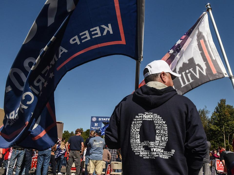 Supporters of Donald Trump wear QAnon branded clothes at rally  (Getty Images)