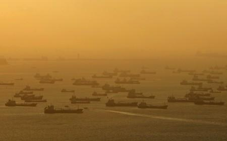 FILE PHOTO: Shipping vessels and oil tankers are seen off the eastern coast of Singapore