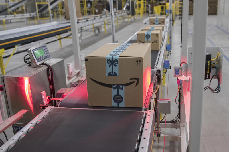 In this Wednesday, Dec. 5, 2018, a box is scanned and weighed before at the Amazon fulfillment center on Staten Island borough of New York. (AP Photo/Mary Altaffer)