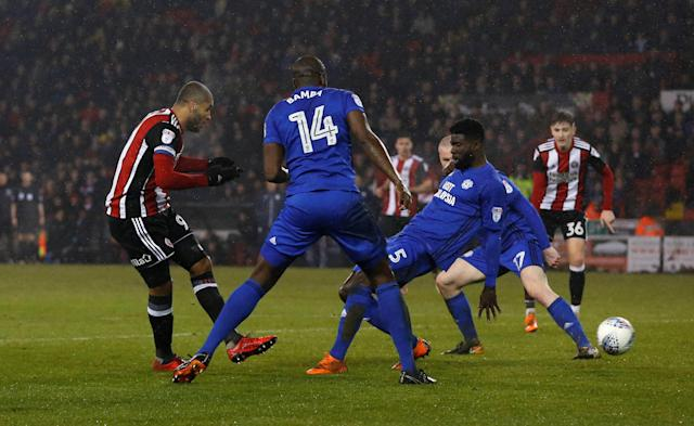 "Soccer Football - Championship - Sheffield United vs Cardiff City - Bramall Lane, Sheffield, Britain - April 2, 2018 Sheffield United's Leon Clarke scores their first goal Action Images/Ed Sykes EDITORIAL USE ONLY. No use with unauthorized audio, video, data, fixture lists, club/league logos or ""live"" services. Online in-match use limited to 75 images, no video emulation. No use in betting, games or single club/league/player publications. Please contact your account representative for further details."