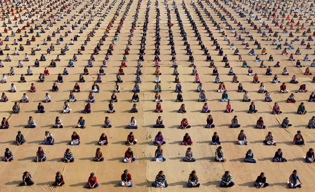 <p>Schoolchildren attend a yoga session at a camp in Ahmedabad, India, Jan. 5, 2017. (Photo: Amit Dave/Reuters) </p>