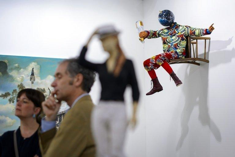 "Yinka Shonibare's sculpture ""Champagne Kid (Perching)"" is pictured at an Art Basel preview on June 11, 2013"