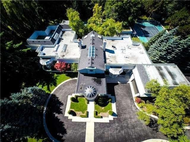 Located at 61 The Bridle Path, Toronto. Asking price: $16,880,000. And of course, it has a tennis court and a pool.