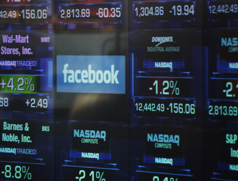 The Facebook logo appears on a display inside the NASDAQ Marketsite in Times Square Thursday, May 17, 2012, in New York. Facebook priced its IPO at $38 per share on Thursday, at the high end of its expected range. If extra shares reserved to cover additional demand are sold as part of the transaction, Facebook Inc. and its early investors stand to reap as much as $18.4 billion from the IPO. (AP Photo/Frank Franklin II)