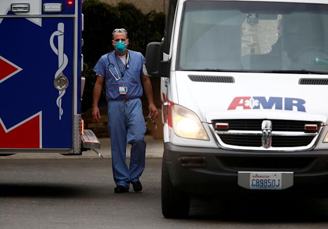 A doctor walks outside the Life Care Center of Kirkland, a long-term care facility linked to several confirmed coronavirus cases, in Kirkland, Wash., on March 5. (Lindsey Wasson/Reuters/File Photo)
