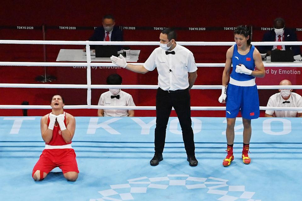 <p>Busenaz Surmeneli of Team Turkey wins the gold medal in the Women's Welter (64-69kg) Final after competing against Hong Gu of Team China. </p>