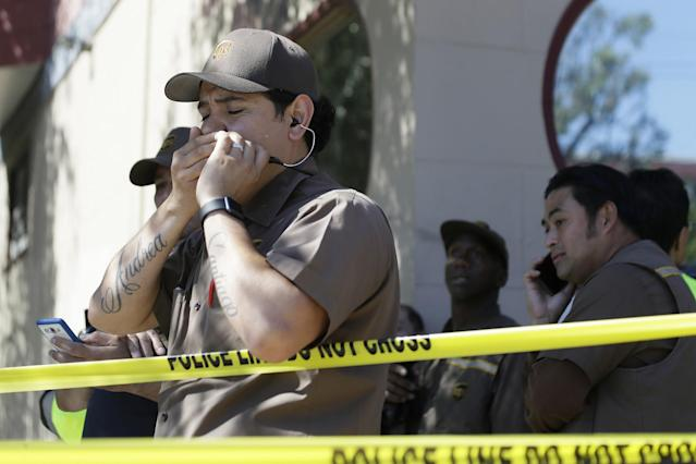 <p>UPS workers gather outside a UPS package delivery warehouse where a shooting took place Wednesday, June 14, 2017, in San Francisco. A UPS spokesman says four people were injured in the shooting at the facility and that the shooter was an employee. (AP Photo/Eric Risberg) </p>