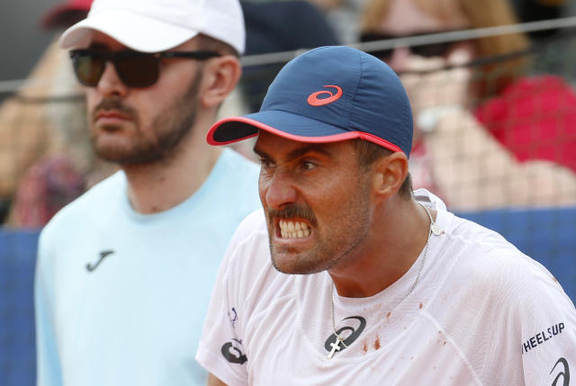 Steve Johnson of the United States pulls a face as he reacts to a line call as he plays against Borna Coric of Croatia during a Davis Cup semifinal singles tennis match between Croatia and the United States in Zadar, Croatia, Friday, Sept. 14, 2018. (AP Photo/Darko Bandic)