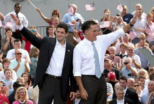 Republican presidential candidate Mitt Romney (right) and his running mate Paul Ryan wave to supporters