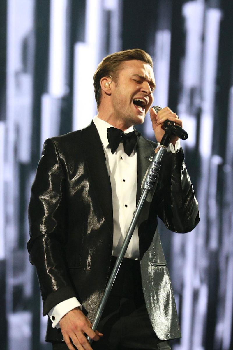 """FILE - In this Feb. 20, 2013 file photo, Justin Timberlake performs on stage during the BRIT Awards 2013 at the o2 Arena in London. Nielsen SoundScan announced Tuesday, March 26, 2013, that the singer's third album, """"The 20/20 Experience,"""" has moved 968,000 units. It's the 19th album in Nielsen's 12-year history that has sold more than 900,000 albums in a single week. (Photo by John Marshall/Invision/AP, File)"""