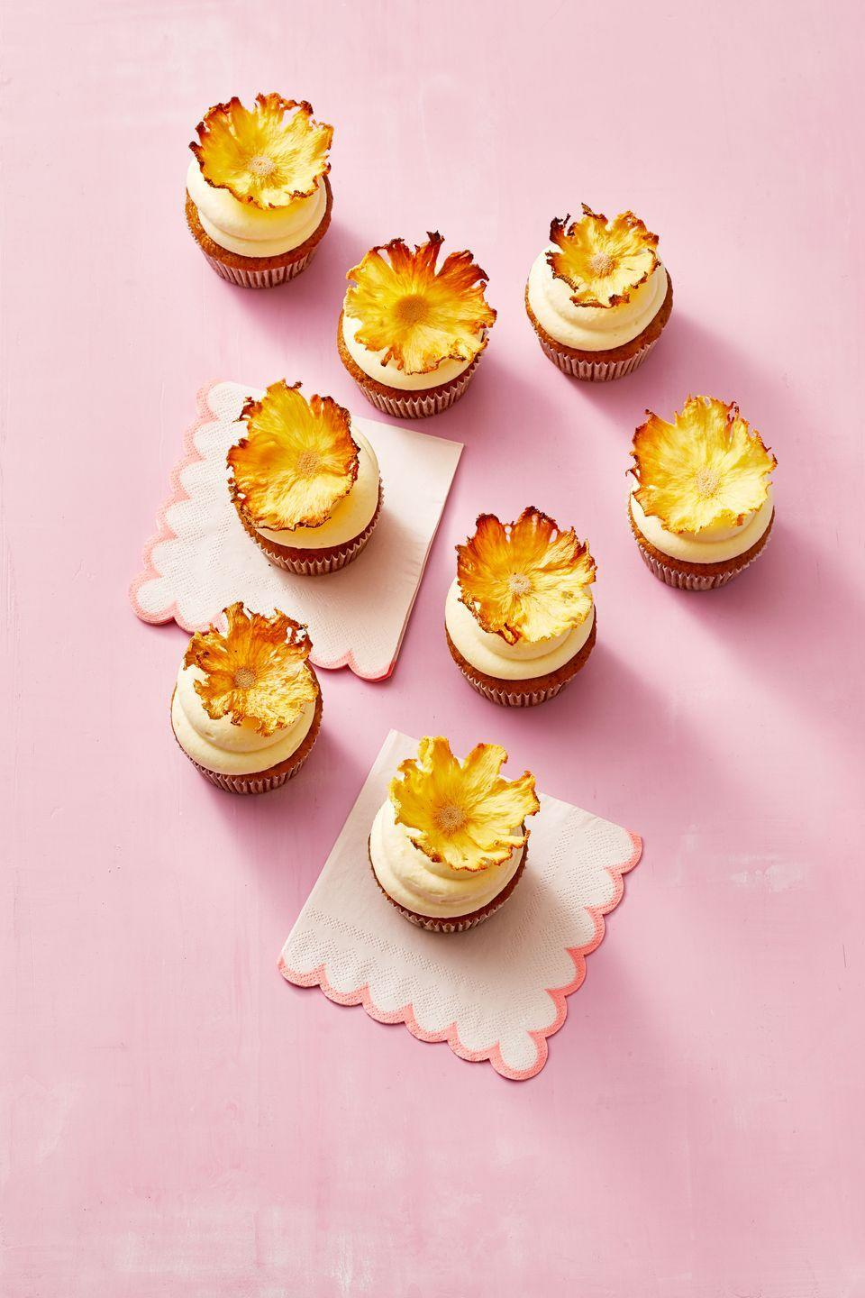 """<p>Carrot, ginger and pineapple cupcakes are perfect for the season—top them with gummy googly eyes instead of dried pineapple for extra spook.</p><p><em><a href=""""https://www.goodhousekeeping.com/food-recipes/a35537898/carrot-pineapple-cupcakes-recipe/"""" rel=""""nofollow noopener"""" target=""""_blank"""" data-ylk=""""slk:Get the recipe for Carrot-Pineapple Cupcakes »"""" class=""""link rapid-noclick-resp"""">Get the recipe for Carrot-Pineapple Cupcakes »</a></em></p>"""