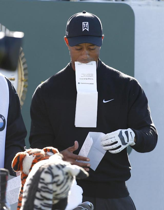 Tiger Woods prepares on the first tee for the final round of the BMW Championship golf tournament at Conway Farms Golf Club in Lake Forest, Ill., Monday, Sept. 16, 2013. (AP Photo/Charles Rex Arbogast)