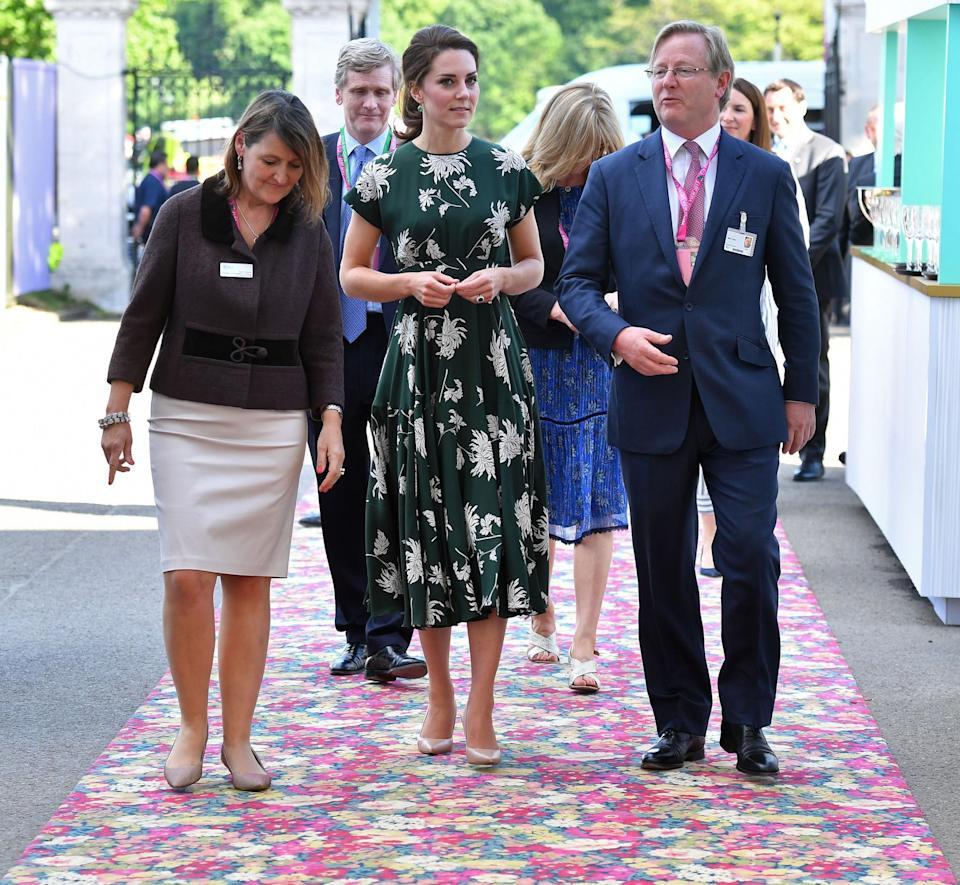 <p>The Duchess turned up to the Chelsea Flower Show appropriately dressed in a green floral design by French label Rochas. Reportedly costing £1500, the fit-and-flare style was paired with nude L.K. Bennett heels and green onyx earrings by Monica Vinader.<br><i>[Photo: PA]</i> </p>