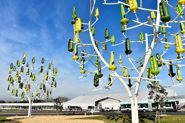 """""""Wind trees"""" with """"leaves"""" that act as mini wind turbines to generate electricity, at the COP21 conference in Le Bourget on December 3, 2015 More than 150 world leaders are meeting under heightened security, for the 21st Session of the Conference of the Parties to the United Nations Framework Convention on Climate Change (COP21/CMP11), also known as """"Paris 2015"""" from November 30 to December 11. (AFP Photo/Loic Venance)"""