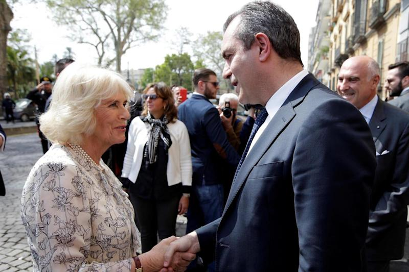 Camilla, Duchess of Cornwall, shakes hands with Naples mayor Luigi De Magistris earlier in the trip (REUTERS)