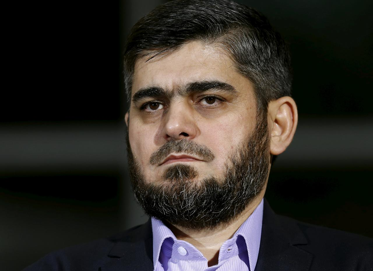 Mohammad Alloush of the Jaish al Islam faction and member of the High Negotiations Committee (HNC) attends a news conference after a meeting with U.N. mediator Staffan de Mistura during Syria Peace talks at the United Nations in Geneva, Switzerland, April 13, 2016.  REUTERS/Denis Balibouse/File Photo     TPX IMAGES OF THE DAY