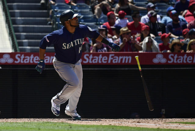 Seattle Mariners' Edwin Encarnacion drops hit bat after hitting a solo home run during the sixth inning of a baseball game against the Los Angeles Angels Sunday, June 9, 2019, in Anaheim, Calif. (AP Photo/Mark J. Terrill)