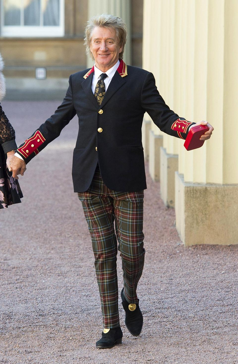 <p>How does one dress for a knighthood? Sir Rod Stewart chose tartan trousers and a regal blazer for his moment in the spotlight. <em>[Photo: PA]</em> </p>