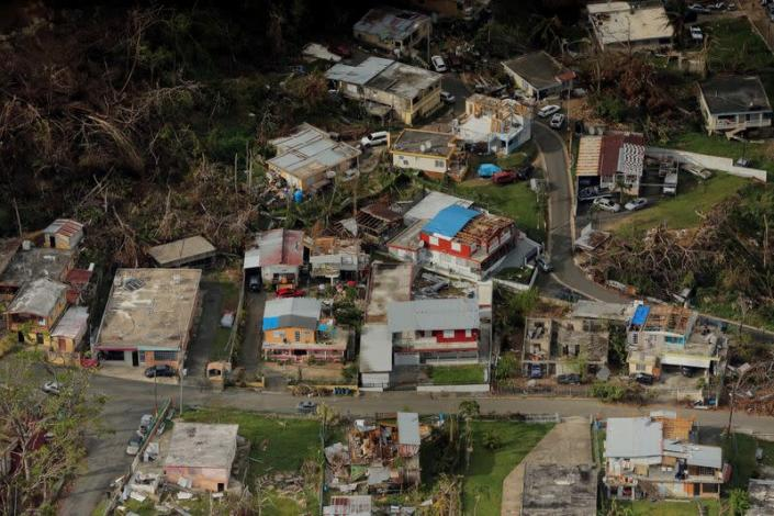 FILE PHOTO: Buildings damaged by Hurricane Maria are seen in Lares, Puerto Rico