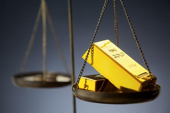 Gold bars on a scale.