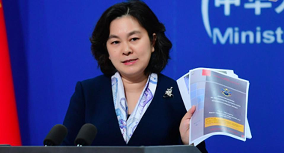Hua Chunying holds up a copy of the Brereton report on Tueaday. Source: FMPRC