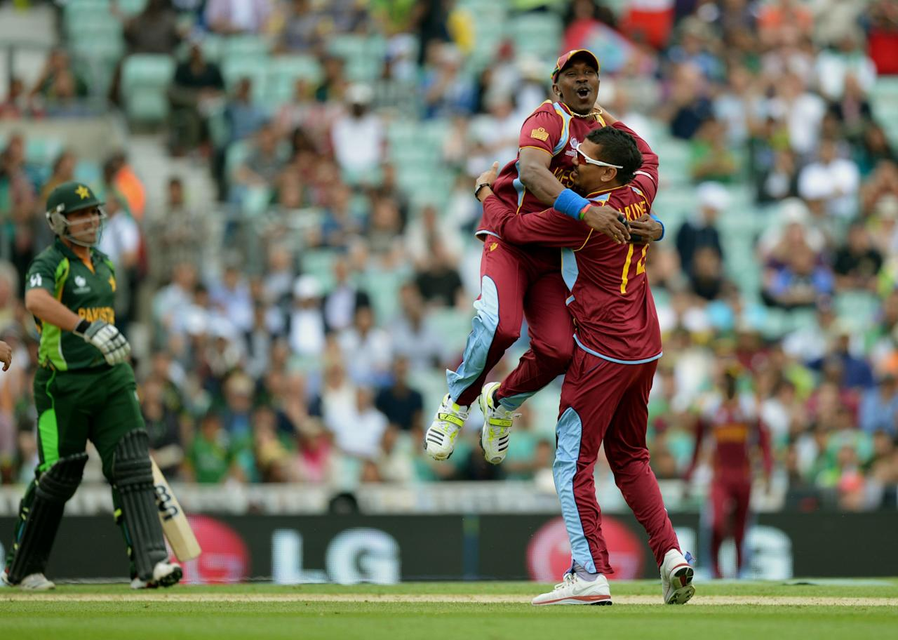 The West Indies' Dwayne Bravo (centre) congratulates Sunil Narine (right) after Pakistan's Kamran Akmal (left) is caught behind during the ICC Champions Trophy match at The Oval, London.