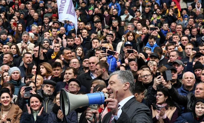 The president spoke to the crowd using a loud hailer (AFP Photo/Genya SAVILOV)