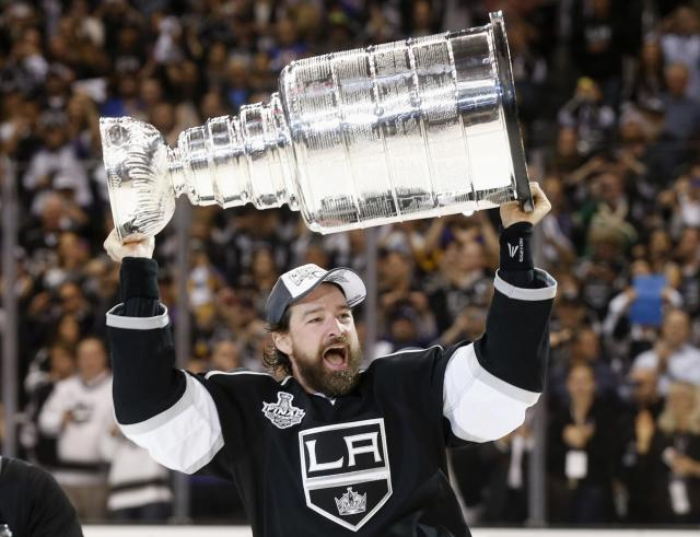 Los Angeles Kings' Justin Williams celebrates with the Stanley Cup after the Kings defeated the New York Rangers in Game 5 of their NHL Stanley Cup Finals hockey series in Los Angeles, California, June 13, 2014. REUTERS/Lucy Nicholson (UNITED STATES - Tags: SPORT ICE HOCKEY)
