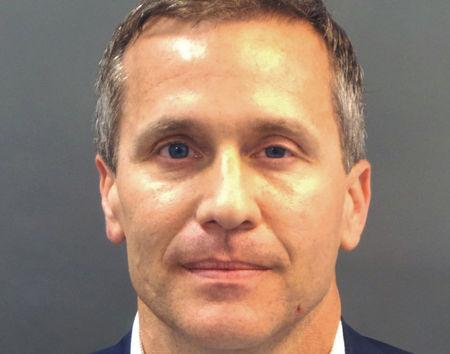 Missouri Governor Eric Greitens appears in a police booking photo in St. Louis