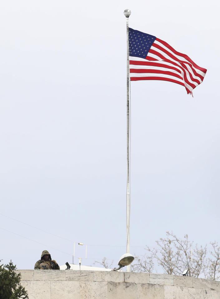 """A U.S. soldier stands guard on the rooftop of the United States embassy in Ankara, Turkey, Sunday, April 25, 2021. Turkey's foreign ministry has summoned the U.S. Ambassador in Ankara to protest the U.S. decision to mark the deportation and killing of Armenians during the Ottoman Empire as """"genocide."""" On Saturday, U.S. President Joe Biden followed through on a campaign promise to recognize the events that began in 1915 and killed an estimated 1.5 million Ottoman Armenians as genocide. (AP Photo/Burhan Ozbilici)"""
