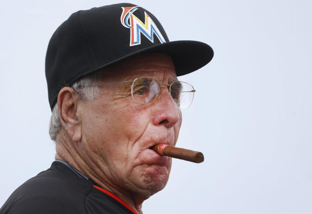 FILE - In this March 11, 2015, file photo, former Miami Marlins manager Jack McKeon chews on a cigar as he wait for the start an exhibition spring training baseball game against the New York Mets in Jupiter, Fla. The Washington Nationals have hired McKeon as a senior adviser to general manager Mike Rizzo, the team confirmed Wednesday, Jan. 30 2019. (AP Photo/John Bazemore, File)