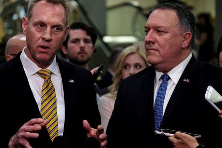 Acting U.S. Defense Secretary Patrick Shanahan, left, and U.S. Secretary of State Mike Pompeo speak to reporters after briefing senators on Iran in Washington